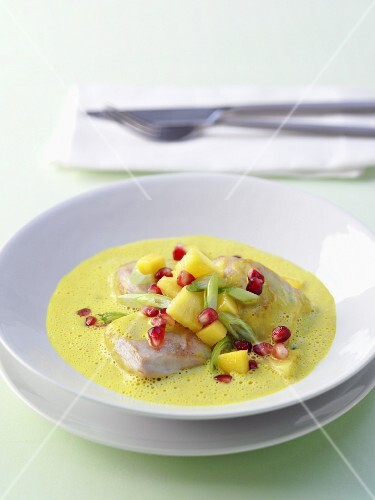 Chicken curry with pineapple and pomegranate seeds