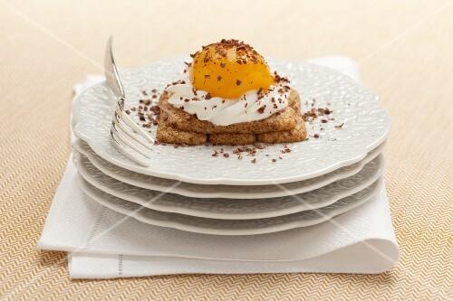 Uova al tegamino (sweet dessert with soaked sponge fingers, cream and peach)