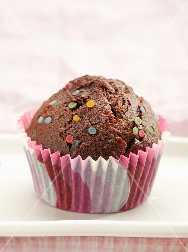 Chocolate muffins with decorative sprinkles