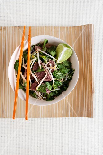 Noodle soup with beef and spinach