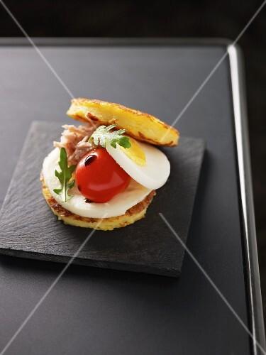 French toast with mozzarella, egg, tomato and tuna