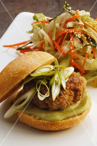 Burger with spring onions and Chinese cabbage salad (Korea)