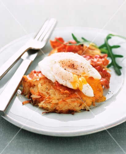 Potato and carrot fritter topped with a poached egg