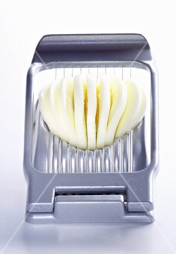 A sliced egg in an egg slicer