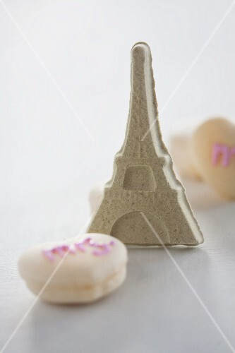 The Eiffel Tower made out of sugar, with macaroons
