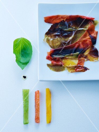 Scorched pepper skins, flesh from the peppers, and basil leaves