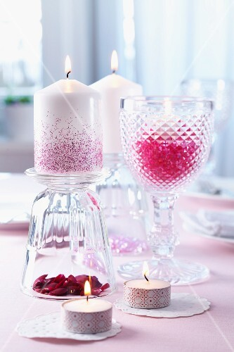 Wine glasses as candle holders and tea lights decorated with masking tape