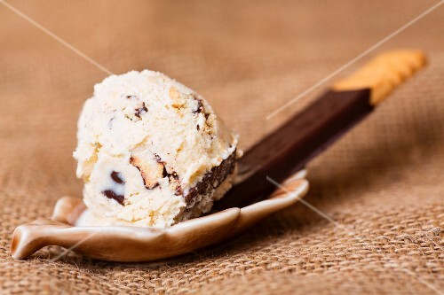 A scoop of home-made cookie ice cream with a biscuit