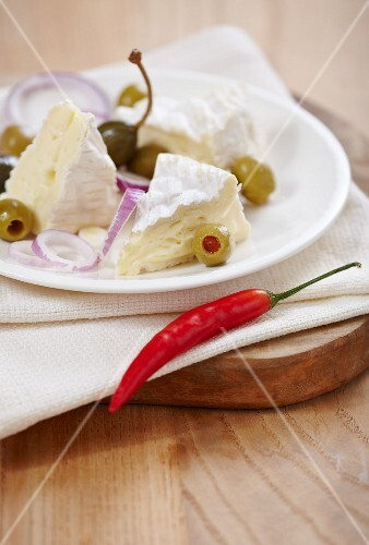 Camembert with olives, capers, onions and a chilli pepper