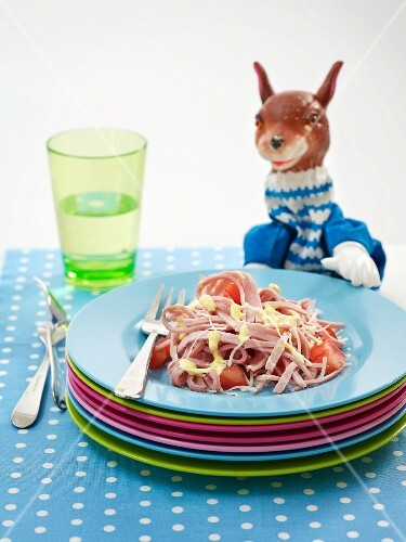 Tomato salad with strips of ham