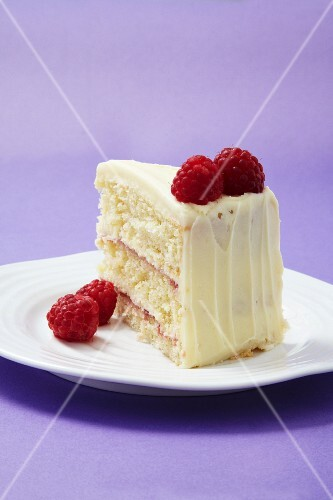 A slice of raspberry and white chocolate layer cake
