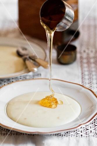 Honey being drizzled over porridge