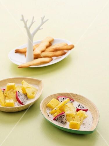 Exotic fruit salad with coconut milk and langue de chat biscuits
