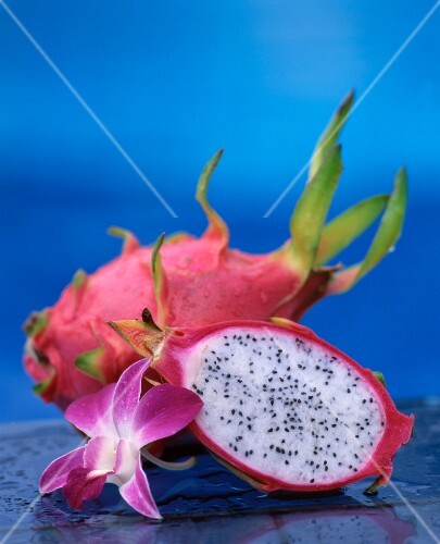 Whole and halved dragon fruit