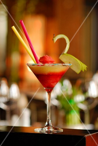 A strawberry Margarita with a slice of apple