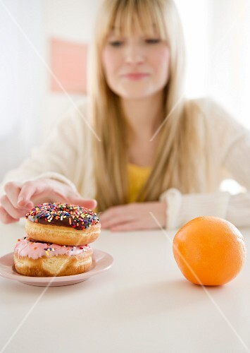 USA, New Jersey, Jersey City, woman reaching for donut