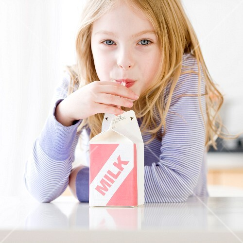 Girl drinking carton of milk