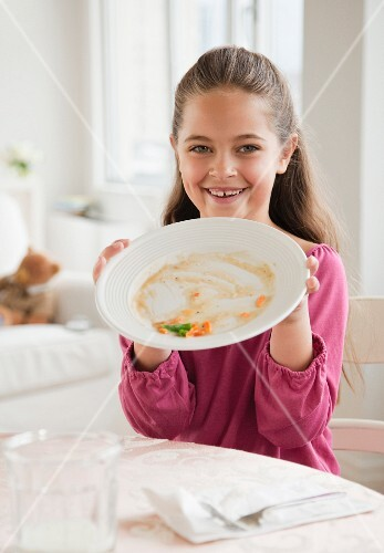 Young girl holding plate