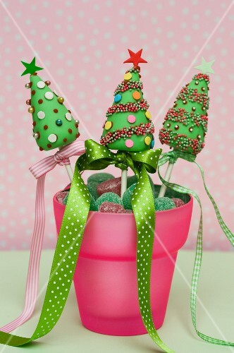 Christmas cake pops in a pot with candies