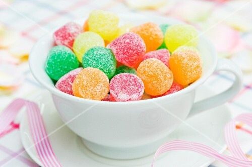 Colorful jelly candies in a tea cup