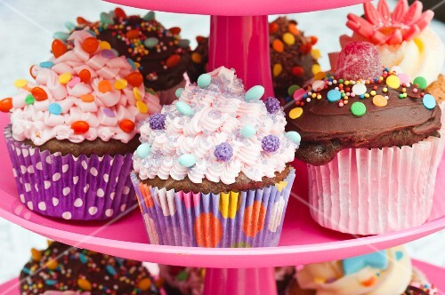 Colorful cupcakes for a party on a cake stand