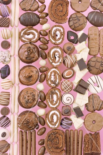 Assorted chocolate candies, cookies and rolls