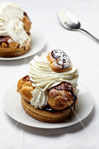 Saint Honore torte with cream and chocolate sauce (France)
