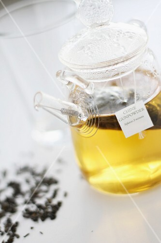 Gunpowder tea with a teabag in a glass jar