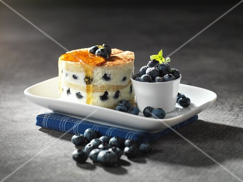 Pancake cake with quark, blueberries and honey