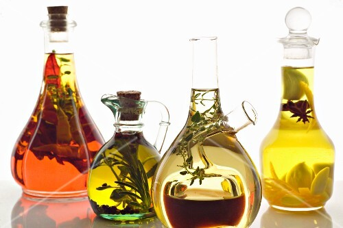 Assorted olive oils with herbs and spices