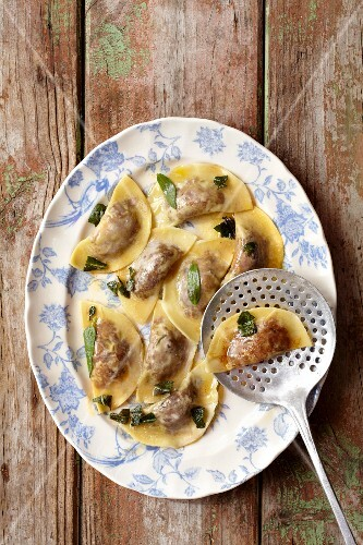 Fried agnolotti filled with lamb in a beurre noisette