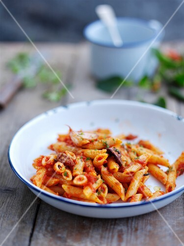 Penne all'arrabbiata (pasta with spicy bacon and tomato sauce, Italy)