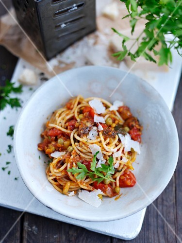 Spaghetti with vegetable sauce and parmesan