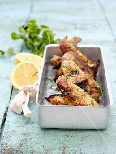 Marinated chicken wings with lemon, garlic and coriander