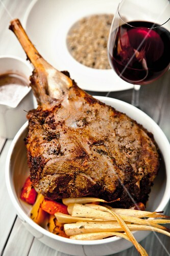 Grilled leg of lamb with oven vegetables and red wine