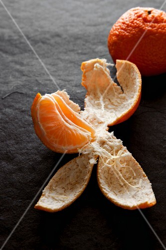 Tangerine wedge in the peel