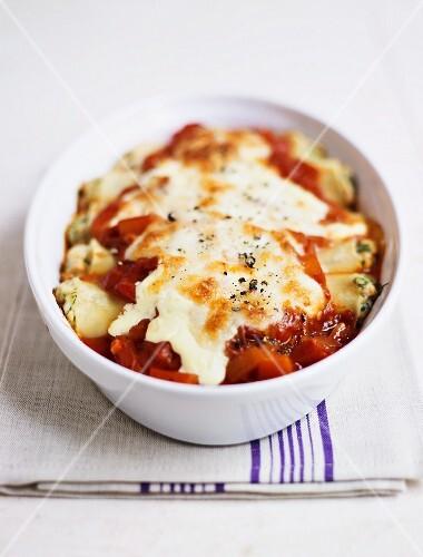 Cannelloni with fish, mozzarella and tomatoes