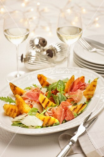 Grilled melon with prosciutto on rocket and parmesan salad at Christmastime