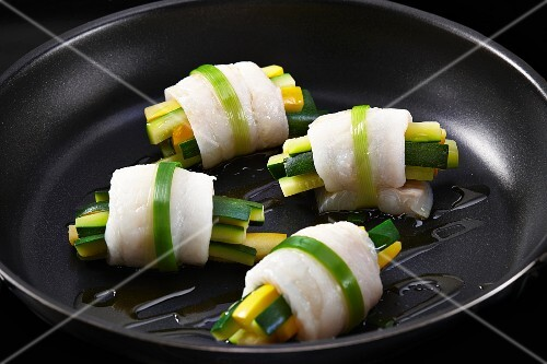 Zander fish wrapped around courgette batons