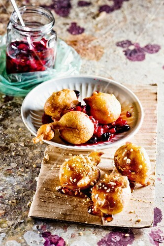 Banana doughnuts with berries and maple syrup