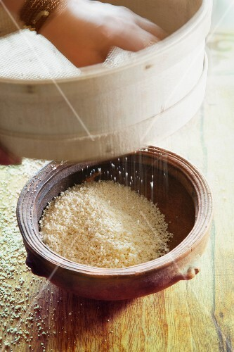 Couscous being sieved