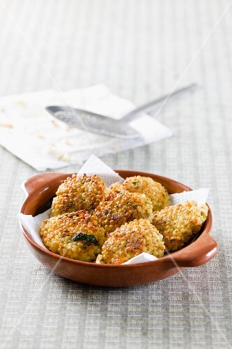Millet fritters in a clay bowl