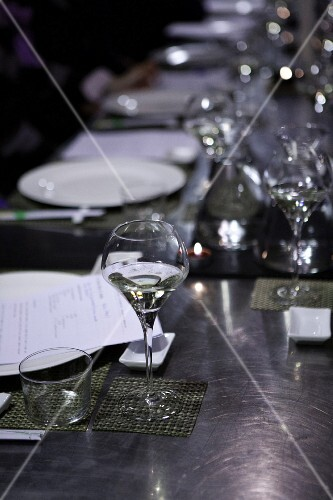 A stainless steel table laid for a meal