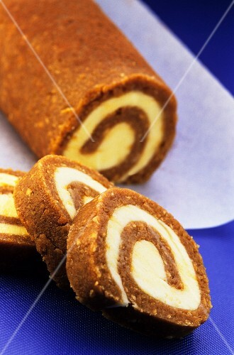Coffee Swiss roll, partly sliced
