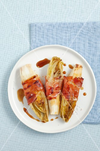 Grilled chicory with smoked ham and a honey and balsamic sauce