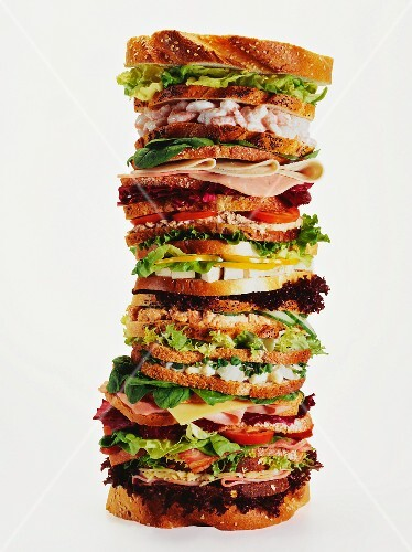 A stack of lots of different sandwiches
