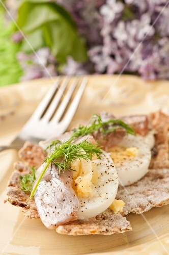 Boiled egg with dill and herring