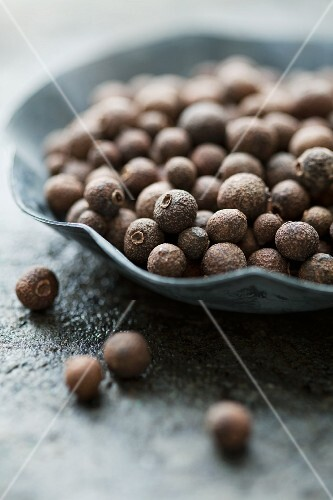 Allspice berries in a small bowl