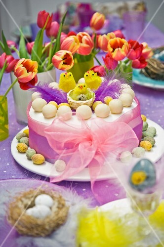 Spring Easter Simnel cake with baby chick and ribbon
