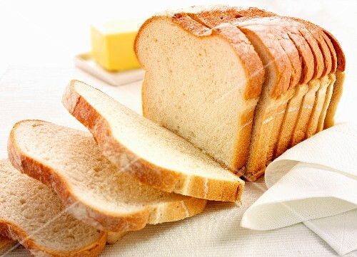 Sliced bread with a pat of butter